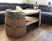 Long coffee table made of wine barrel halves natural