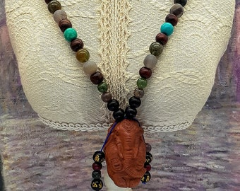 Ganesh Mala Style Necklace with Tibetan Silver, Turquoise, India Agate, matte Agate, and Sandalwood Beads.  Carved wood Pendant.