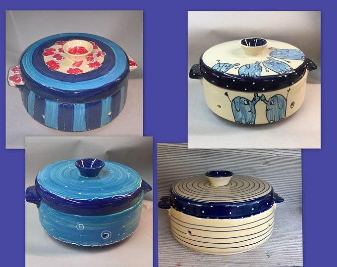 large ceramic bread pot in various blue patterns