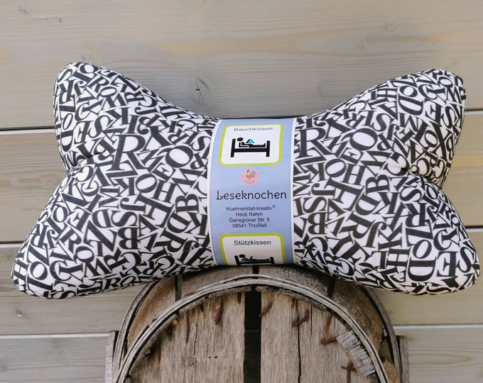 Reading bone / reading pillow / pillow / side sleeper / relaxation / backrest / reading / neck pillow / letters / black and white