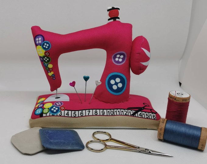 Pink large sewn pin cushion with wooden floor in the shape of a sewing machine / pin / needles / sewing / decoration / sewing machine / sewing room