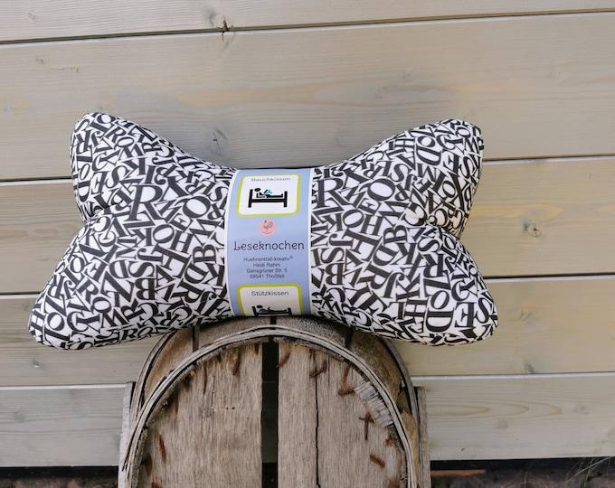 Reading bone / reading pillow / pillow / side sleeper / relaxation / backrest / reading / neck pillow / letters / black and white