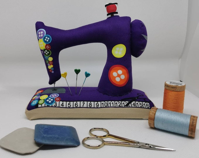 Purple large sewn pin cushion with wooden floor in the shape of a sewing machine / pin / needles / sewing / decoration / sewing machine / sewing room
