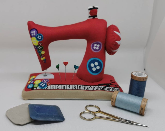 Red large sewn pin cushion with wooden floor in the shape of a sewing machine / pin / needles / sewing / decoration / sewing machine / sewing room