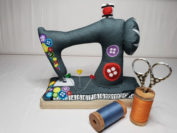 Large sewn needle cushion with wooden floor in the form of a sewing machine