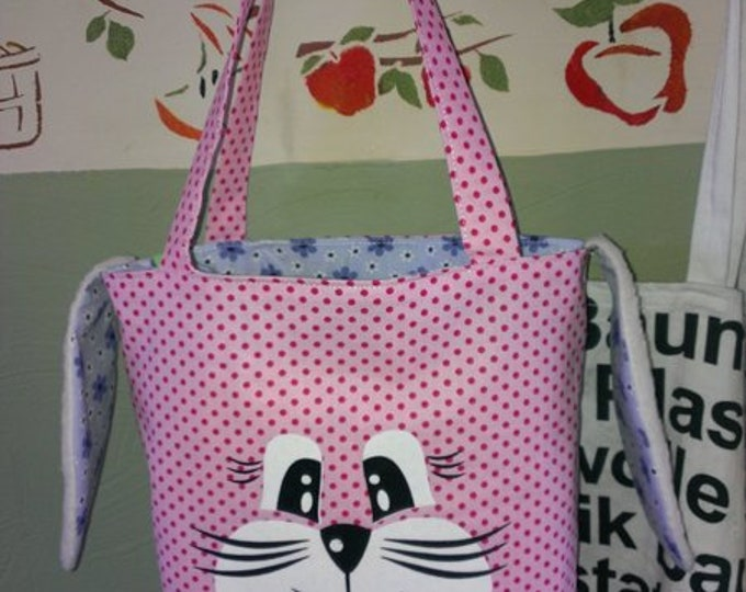 Bunny face plotter with ebook pouch