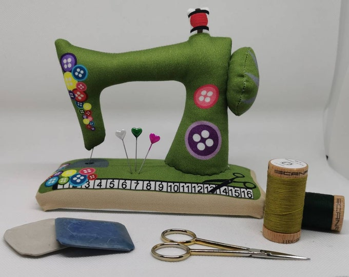 Green large sewn pin cushion with wooden floor in the shape of a sewing machine / pin / needles / sewing / decoration / sewing machine / sewing room