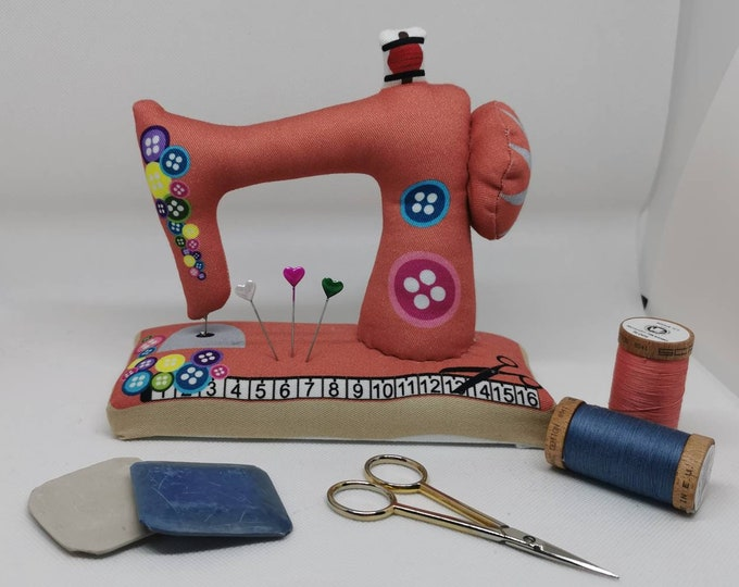 Salmon-coloured large sewn pin cushion with wooden floor in the shape of a sewing machine / pin / needles / sewing / decoration / sewing machine / sewing room