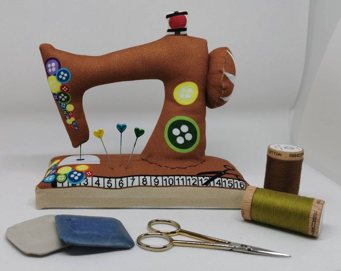 Brown large sewn pin cushion with wooden floor in the shape of a sewing machine / pin / needles / sewing / decoration / sewing machine / sewing room