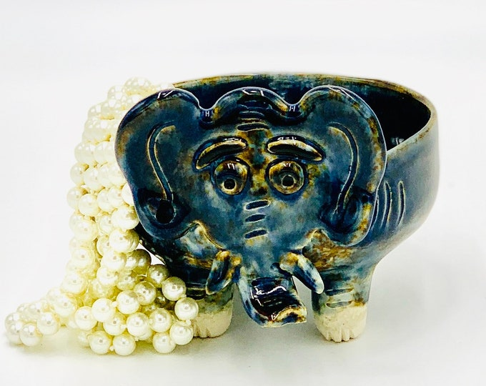 Elephant in White Clay Ceramic or Pottery Bowl