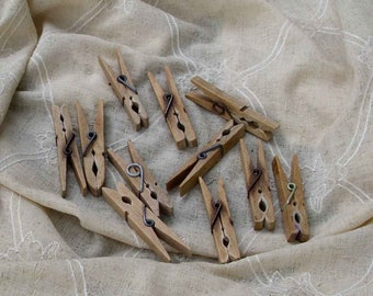 Old wooden clips antique clothespins