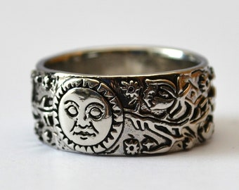 Ring antique silver sun and moon symbol, floral ornaments