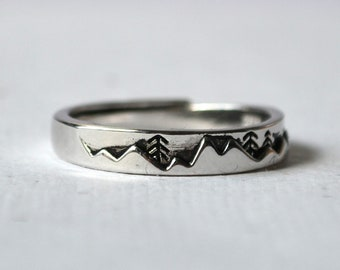 Open antique silver ring forest and mountains