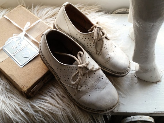 Old children's shoes, white, shabby, vintage decoration, brocante