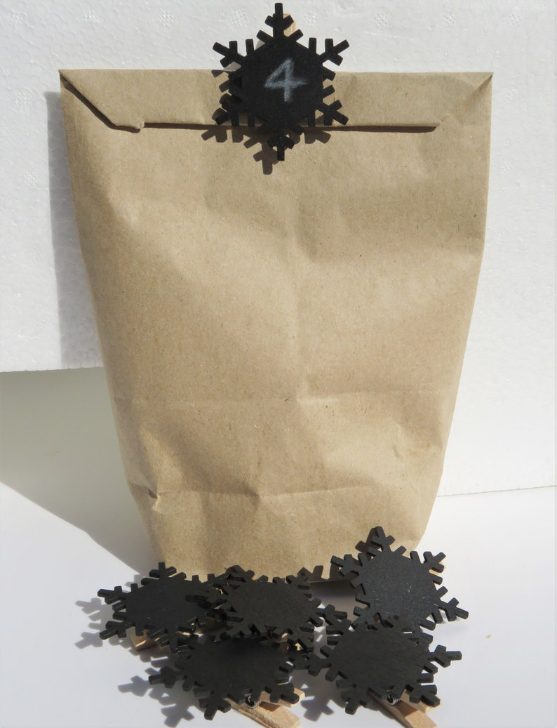 24 staples with black wooden snowflake for hanging advent calendar bags Advent calendar
