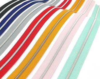 1 meter metallized zipper, narrow, incl. 3 sliders, different colors