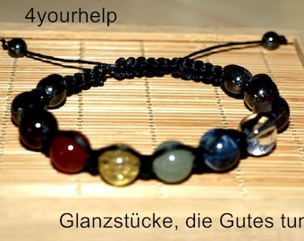 Makramee bracelet with chakra stones and hematite traditionally braided