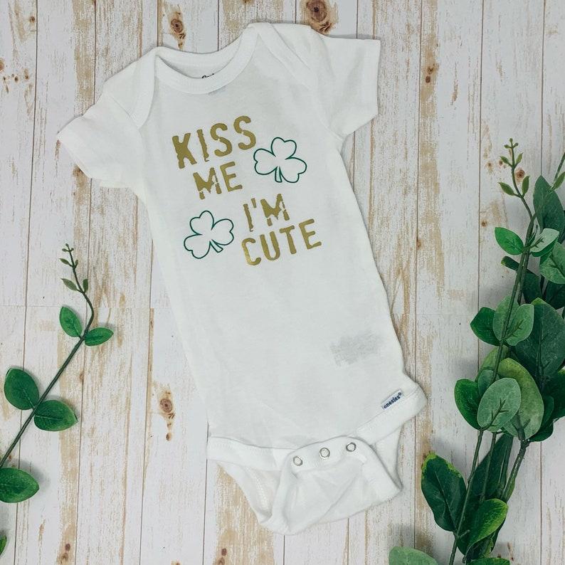 Kiss Me I\u2019m Cute St Patrick\u2019s Day Baby Bodysuit