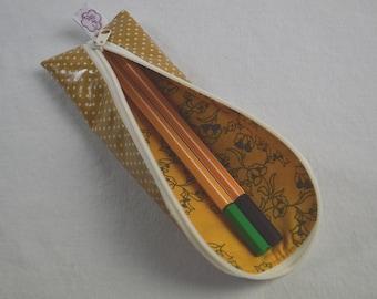 Pencil case points on ochre