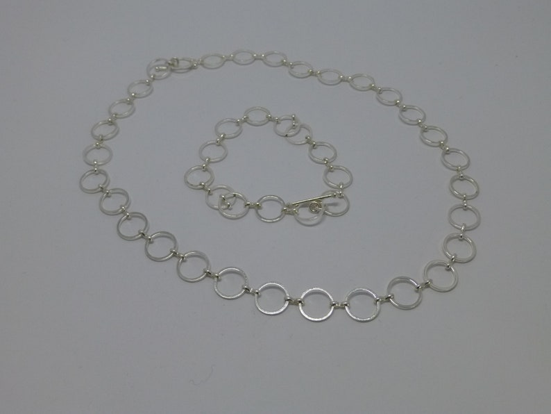 Member strap Round Silver