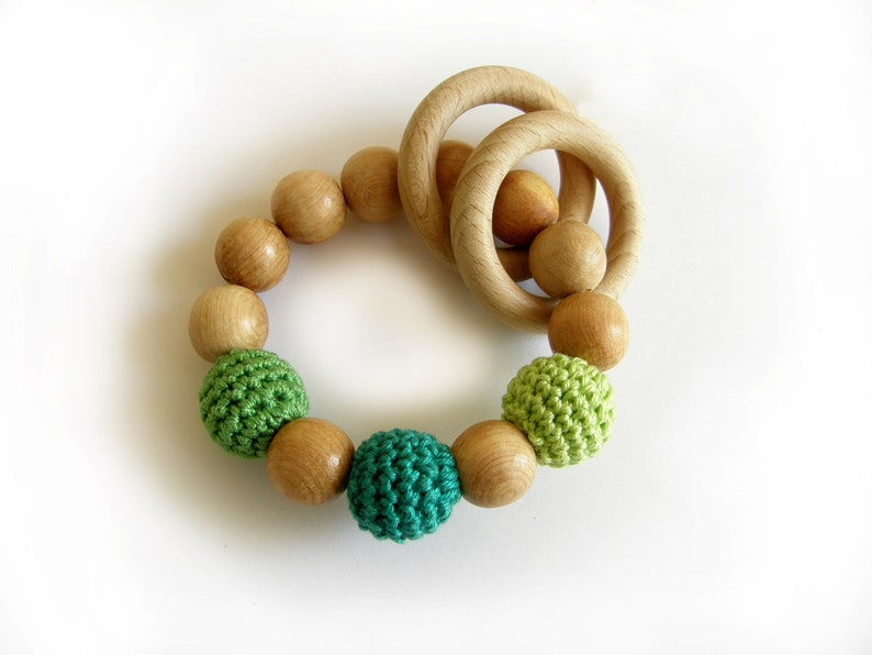 Green baby rattle
