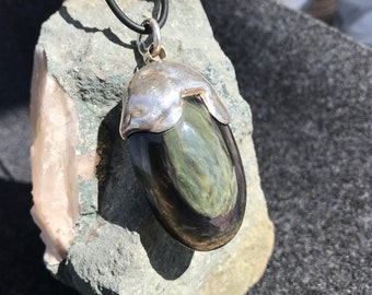 Unique, oval rainbow obsidian with a shapely 925 silver setting