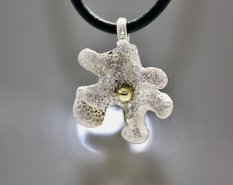 A massive coral crown as a pendant made of 925 silver with a 14ct gold pearl