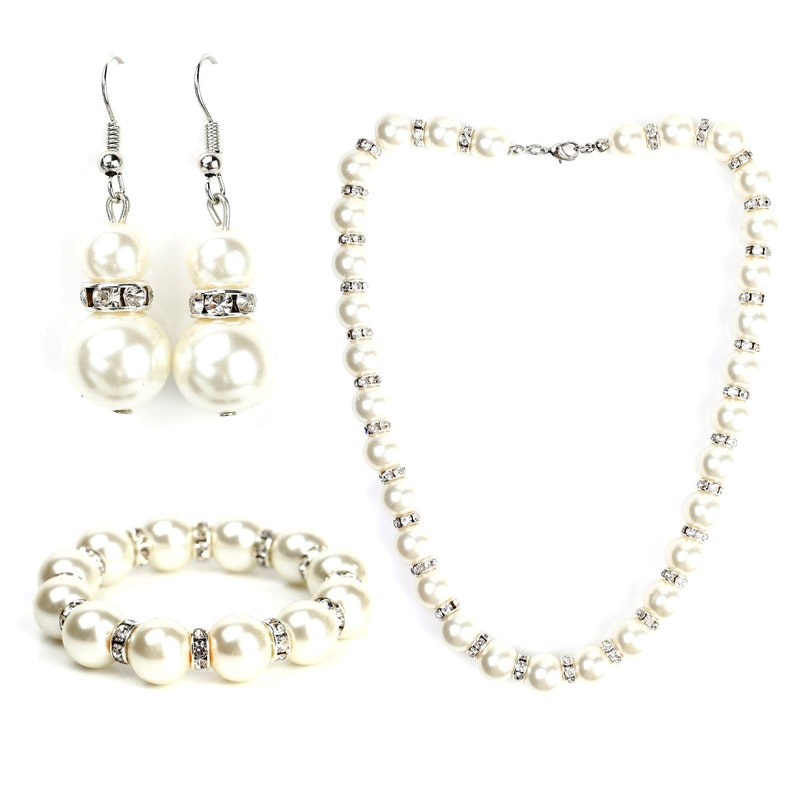 United Elegance Timeless Faux Pearl /& Crystal Jewelry Set With Necklace Drop Earrings and Bracelet