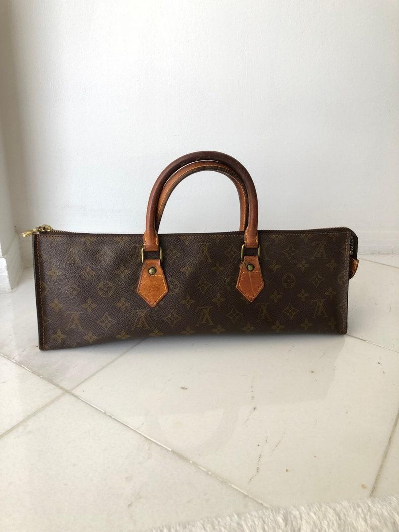 060e1fee2290 Louis Vuitton Authentic Vintage Sac Tricot Monogram Handbag