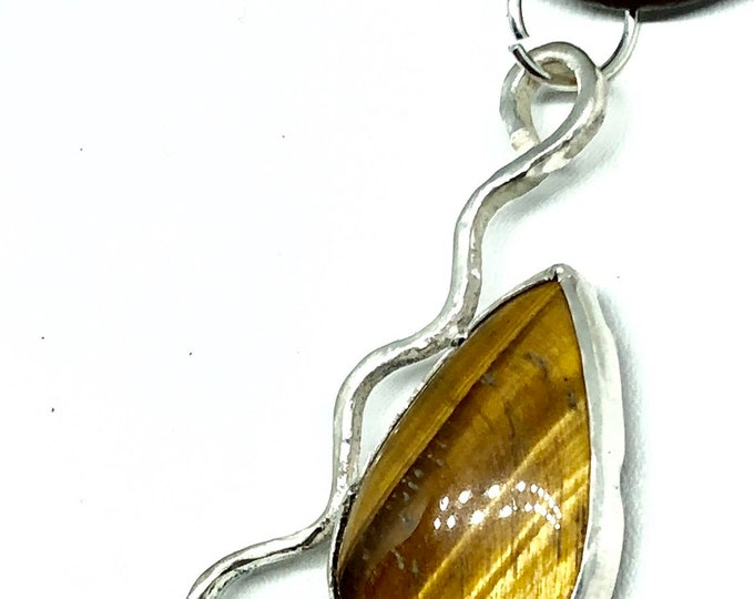 Handmade Tiger Eye Cabochon set in Silver modern design Pendant