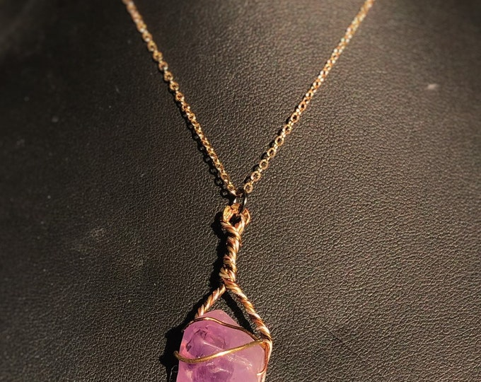 Genuine uncut Amethyst, silver, brass and copper twist pendant