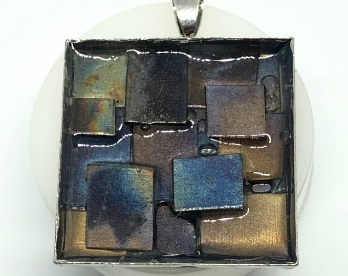 Outback Shed 3 - heat worked titanium pendants