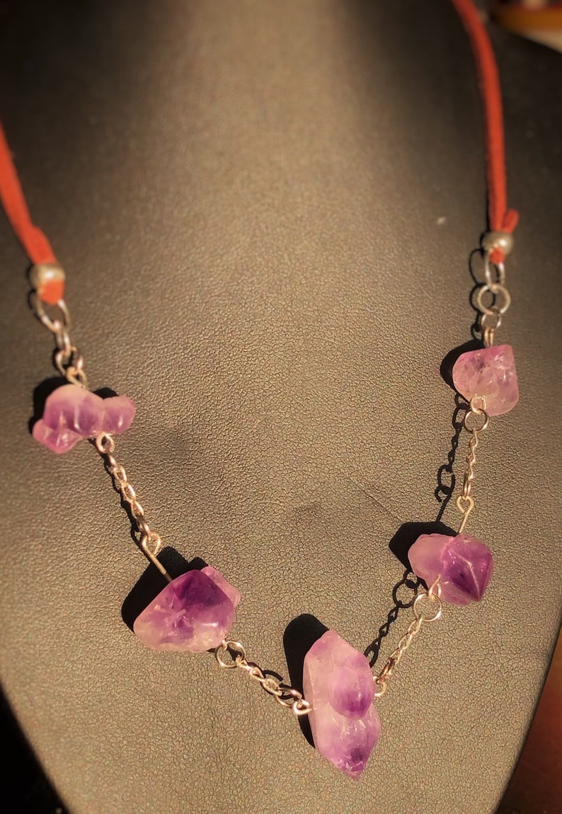 silver and leather necklace. Genuine uncut Amethyst