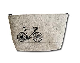 Toiletry bag man, bicycle