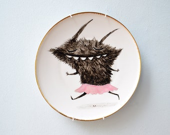 Wall plate with hand-painted black monster as ballerina