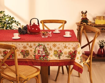 Christmas Holiday Tablecloth in Red and Cream colors with print of Santa, Ornaments and Snowflakes