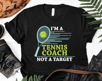 19c36a6b I'm A Tennis Coach Not A Target Funny Tennis Gift Tee Unisex