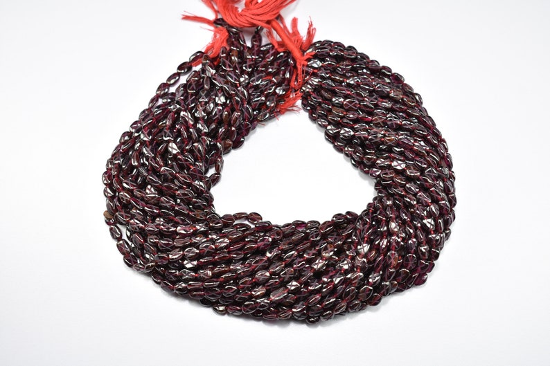 Natural Garnet Carved Oval Shape Gemstone Beads 13 Inch 1 Strand 5X6mm to 5.50X8mm