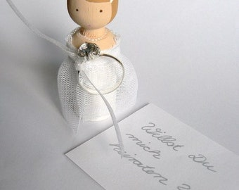 Will you marry me?wooden doll