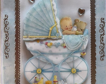 Greeting card for the birth in 3D technology with baby in the stroller