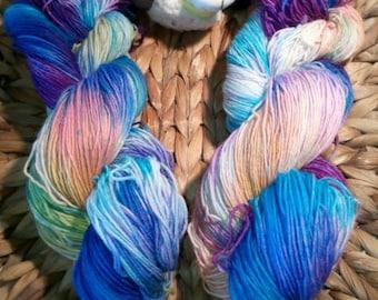 1 strand hand dyed sock yarn 4 ply orange, light blue, blue, violet from the CreativCorner