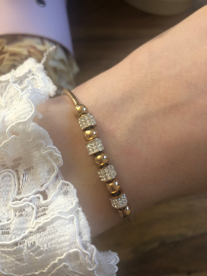 Bracelet rose gold sliding closure Check out the great details! Round pendant with cubic zirconia