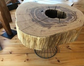 Coffee table made of chestnut solid wood tree disc on a metal frame