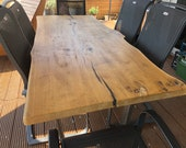 Terrace dining table made of an oak plank quality from the Lower Rhine