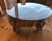 Coffee table made of chestnut solid wood tree disc on rolls