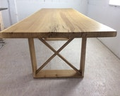 Dining table made of an oak plank about 1 meter wide