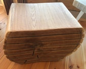 Coffee table made of oak solid wood from a tree trunk
