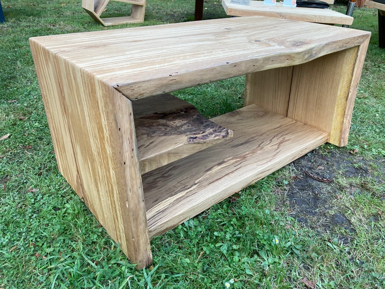 Coffee table made of solid oak wood from a continuous plank image 1