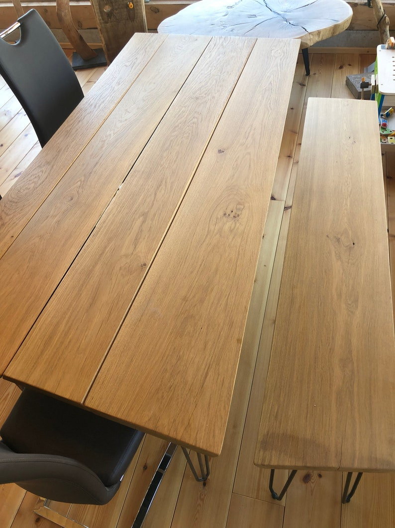 Dining table Diningtable in oak with slanted edges and steel image 0