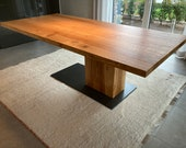 Dining table made of an oak plank on 1 1/2 legs unique